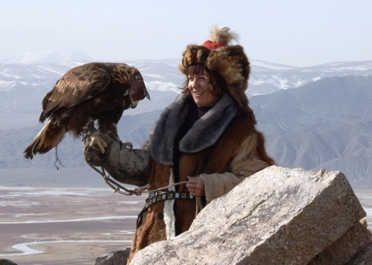 Sue Fox holding an Eagle in Western Mongolia